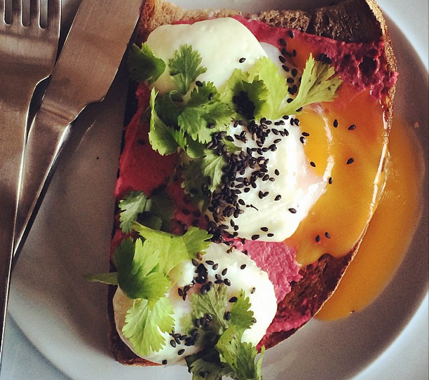 brunchandstuff.com Beetroot dip on sourdough with poached eggs, coriander and black sesame.